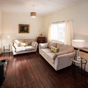 The living room has a wooden floor, and there's also a study