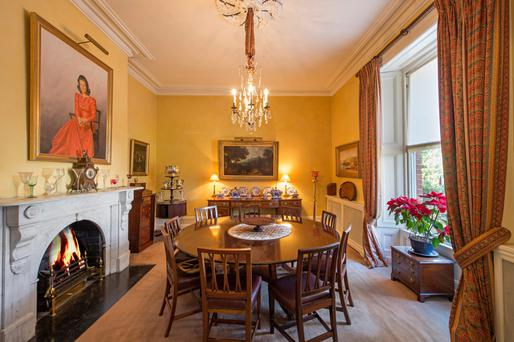 The dining room features a marble fireplace.