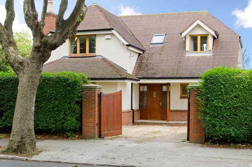 The four-bedroom dormer bungalow is accessed through electric gates.
