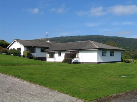 The house is 3,229 sq ft and sits on four acres of land with gardens and paddocks.