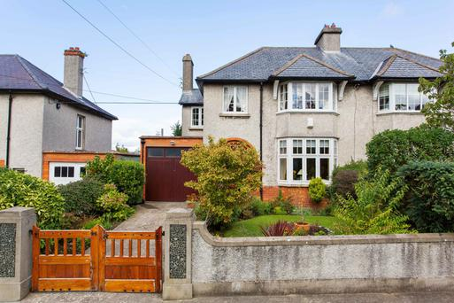 The four-bedroom house has a 100ft back garden with raised terrace and lawn