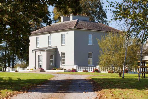 Built in 1831, the handsome residence has a guest wing and sits on more than 16 acres