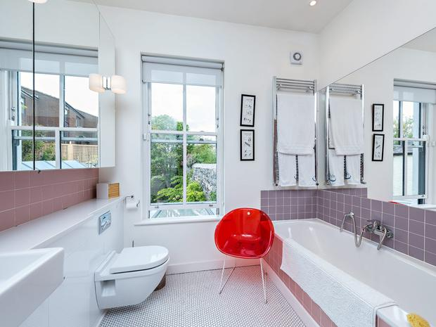 The bathroom features a concealed TV