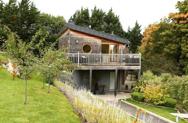 The house is built from cedar wood, and is based on the designs of Norwegian homes.