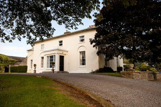 Tullyard is a two-storey house with a three-storey wing to the side.