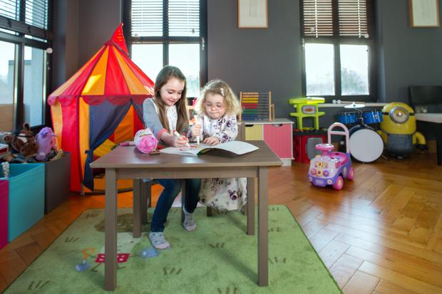 Daughters Blair and Bebhinn in the play area, which is housed in the dining room, also off the kitchen.