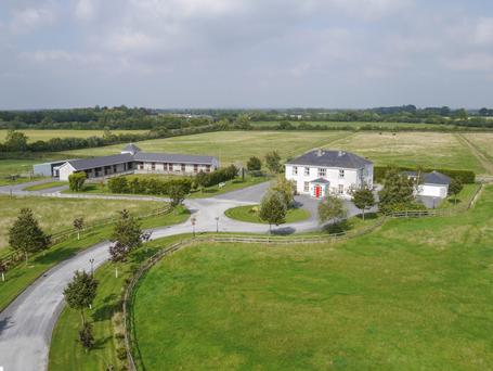 The two-storey house sits in the middle of a 33.5ac stud farm with two stable yards and seven paddocks