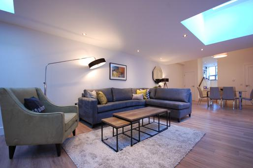 The living room with skylight feature.