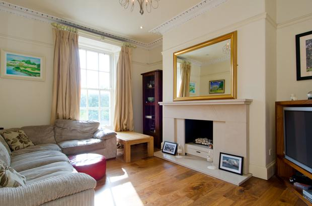 The drawing room with open stone fireplace.