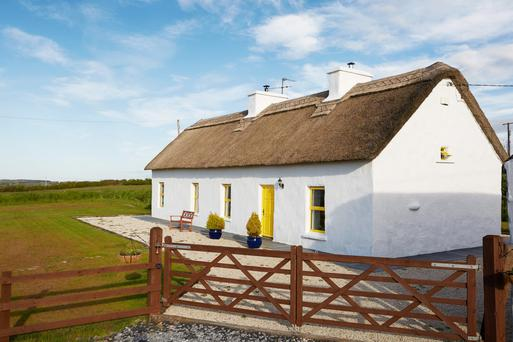 Thatch cottage has been restored and is in pristine condition.