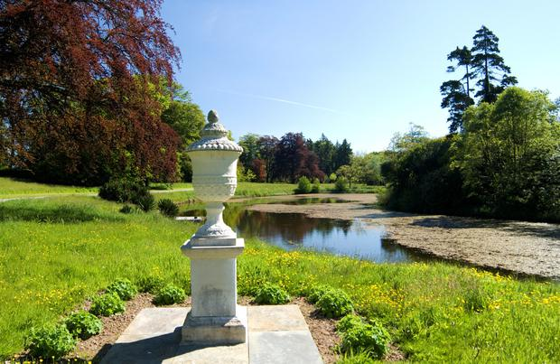 An ornamental urn adds a touch of panache to the grounds.