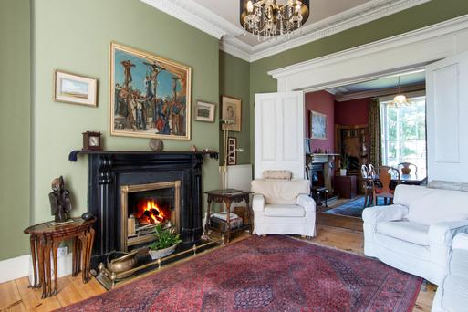 The drawing room is one of two reception rooms and features an original fireplace.
