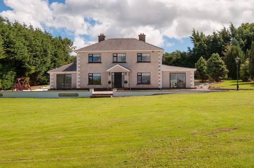The house sits on 120ac with views of the countryside as well as the sea at Bray.
