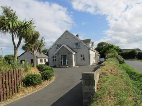 Ballyell House comes with a cottage, and a garage with commercial planning permission.