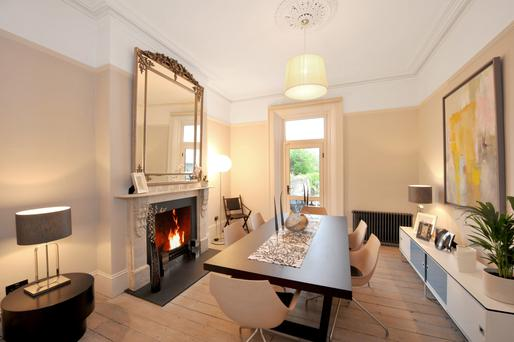 The dining room with Carrara marble fireplace.