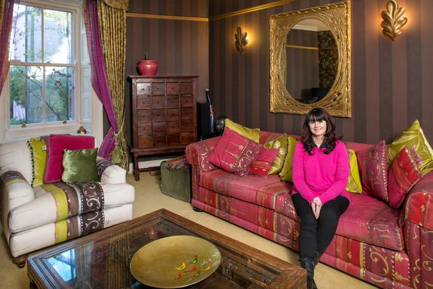 Marian Keyes in her drawing room. She's sitting on a sofa which she bought with her first royalty cheque. It's covered in Designers Guild fabric. Photo: Tony Gavin.