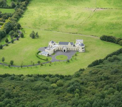 Kells Country House is a former guesthouse, it has turrets, battlements and a round tower.