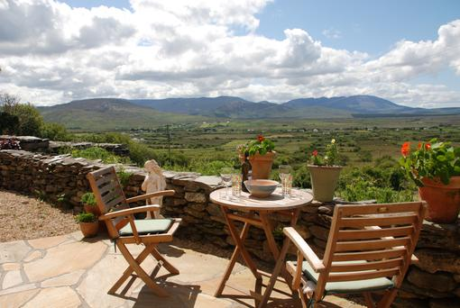Take in the glorious views from the property's tranquil garden terrace.