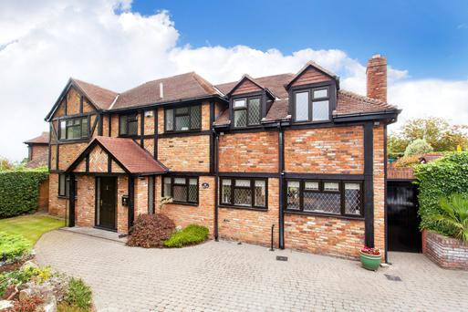 The Tudor-style home enjoys complete privacy behind electric gates and high hedges.