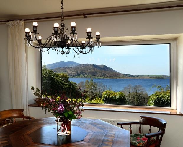 The sitting/dining room has views over the lake.
