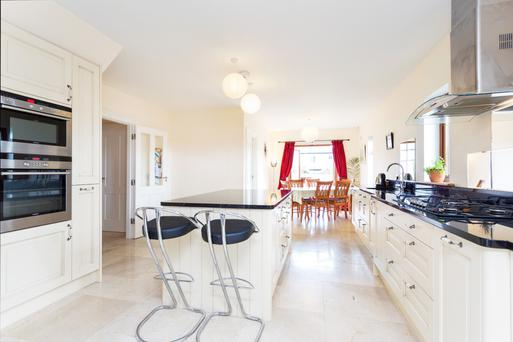 The open-plan kitchen with centre-island and breakfast and dining area at Bramble Bank.