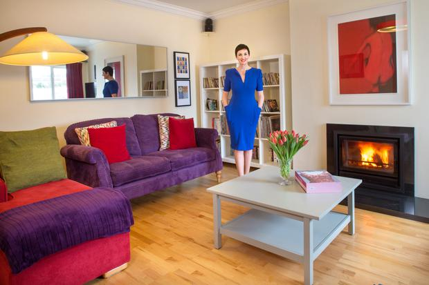 Susan Fox of Eden Beauty Group in her living room, which is furnished in bright splashes of colour. Her husband Steve has two passions - cars and vinyl. Susan tolerates the albums on her shelves. There's a garage for the cars.