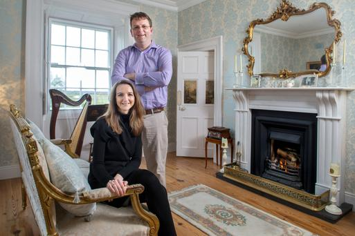 Peter and Alison in the drawing room. The gilt sofa is very special to Alison, as it was bought for her 40th birthday by her mother, who died last Easter. She got it in the Store Yard, Portlaoise