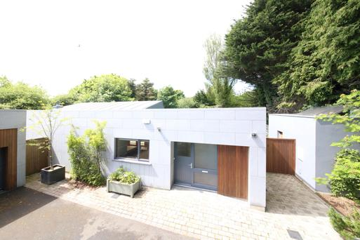 This contemporary bungalow is 1,647 sq ft and designed in a L-shape.