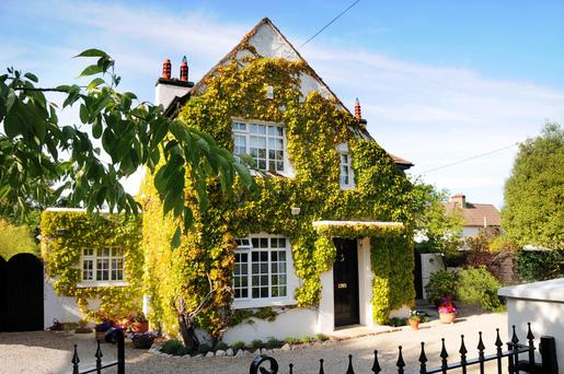 Behind the ivy-clad facade is a 2,196 sq ft home which has been extended and renovated.