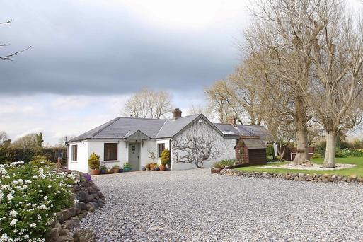 The cottage, which dates from the 1920s, has been extended but retains its character.