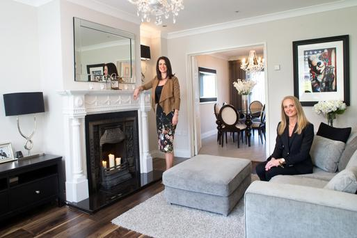Grace Macdonald, left, and Angelina Ball in Angelina's living room, which is painted in Cornforth White by Farrow & Ball. The chenille sofas are from Ashleaf, a range stocked in Phoenix Interior Design. The picture is by Terry Bradley, a favourite with both women.