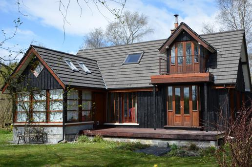 Derrynaneal is a timber-framed and timber-clad eco home set in a woodland area