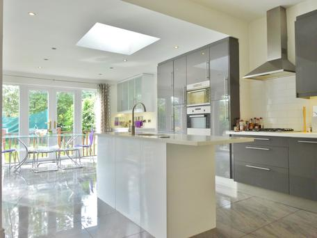 The kitchen is modern with a central island.