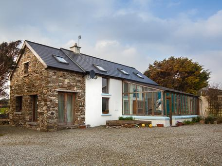 The four-bed farmhouse-style property has been renovated to make the most of the light, while keeping original features intact.