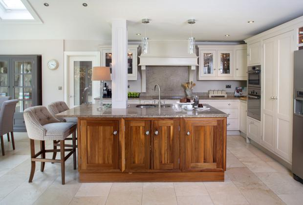 Belinda designed the kitchen units herself and the walnut island. The worktops are granite and the flooring is crema marfil tiling. Photo: Tony Gavin.