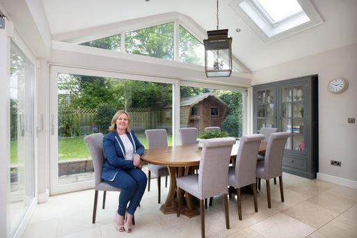 Belinda in the light-filled dining area, which is part of the extension. 'A south-facing kitchen/dining area was a must as it's where you spend your day,' Belinda notes. Photo: Tony Gavin.