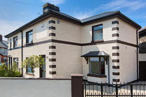 At the back of this semi-detached property is a roof garden, decked and fenced for privacy.