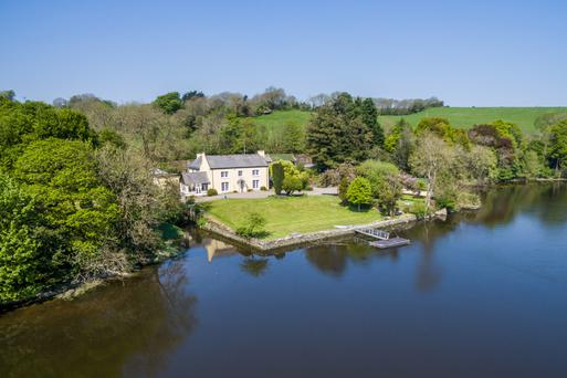The property comes with 140 metres of river frontage and has a jetty and boathouse.