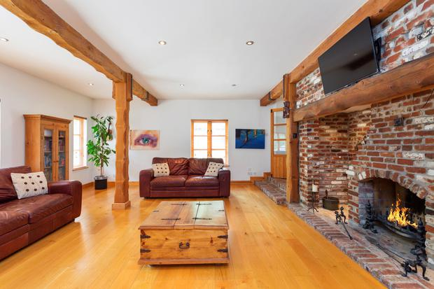 The living room with an open fireplace.