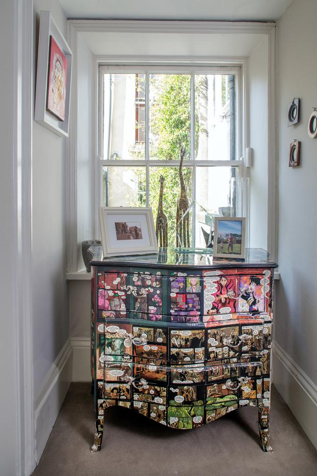 Oonagh bought this chest in Paris because she loved the comic-book element of the decoupage.