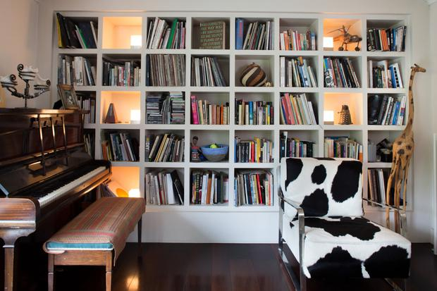 People tend to put bookcases in alcoves, but Peter and Aideen opted to make a wall of bookshelves in their living room. The calfskin chair is from Arnotts.