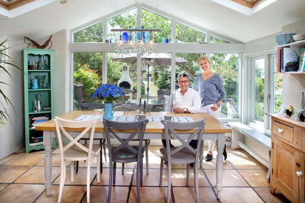 Jewellery designer Sabine Lenz and her husband Len Lipitch in the light-filled conservatory they added 10 years ago, off the kitchen. Photo: Tony Gavin