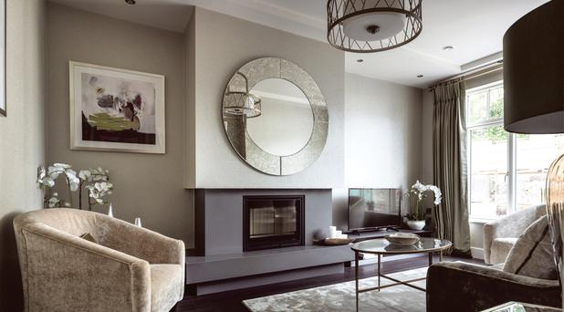 The living room is decorated in a colour scheme of khaki green and oyster tones mixed with 'gilver' - a cross between silver and gold - furnishings