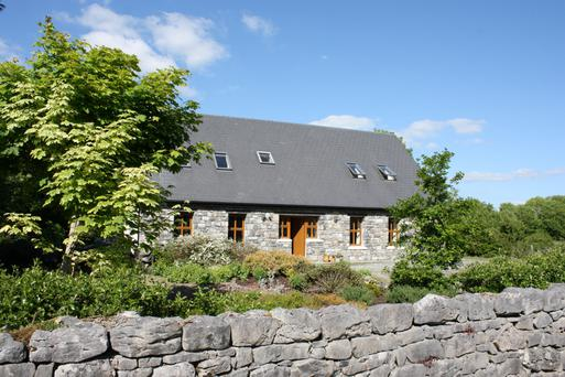 This 2,600 sq ft four-bedroom stone home is decorated in traditional cottage style