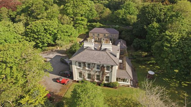 The Old Rectory sits on five acres of lush gardens