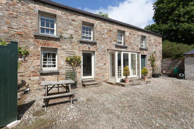 Further accommodation in the coach house includes two bedrooms