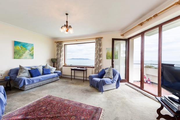 The living room has a balcony to take in views of the Irish Sea