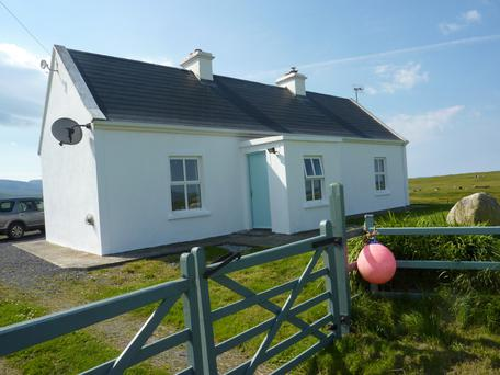The cottage in Doughmakeon enjoys views of the sea at the front and Croagh Patrick at the back