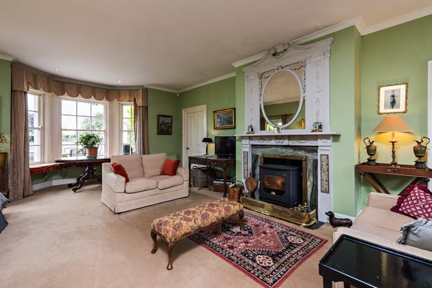 The reception rooms include period fireplaces