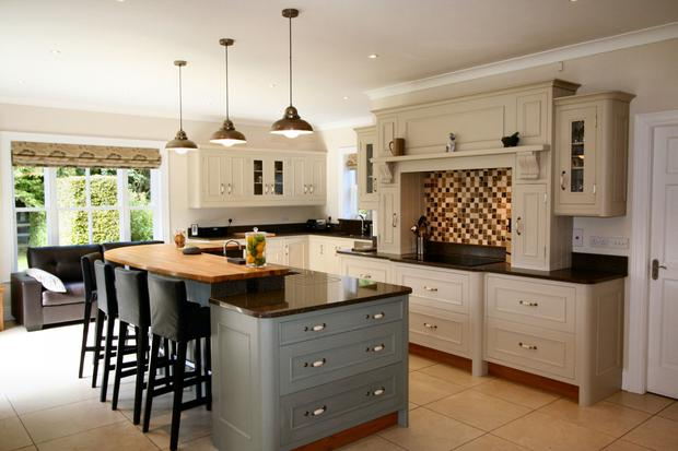 The kitchen is fitted with tulipwood units and has a centre island